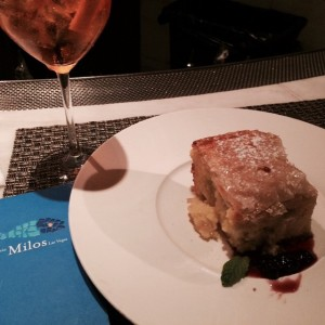 Aperol Spritz & Galakatobouerko made with Seminola custard wrapped in crispy phyllo..for desert at Milos in the Cosmopolitan. #milos #estiatoriomilos #cosmopolitan #lasvegas #lasvegasstrip #desert #aperol #aperolspritz #custard #phyllo #mediterranean #mediterraneanfood #greekfood #lonedinerusa Follow the LoneDiner on his eating adventures at LoneDinerusa.com to catch up with latest dining reviews